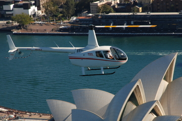 Excursão privada: Voo de helicóptero e almoço no Porto de Sydney