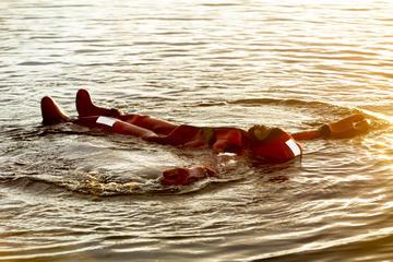 Midnight sun floating in a Lake in Rovaniemi