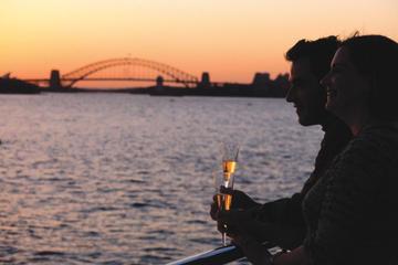 Middag og solnedgang i Sydney Harbour