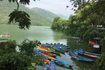 Explore Fewa Lake on rowing boat with