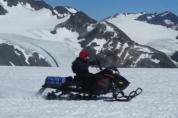 Snowmobile on Godwin Glacier via Helicopter access