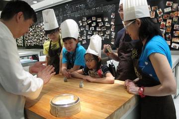 Cours de cuisine autour des dim sum à...