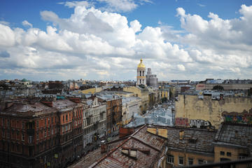 ' ' from the web at 'https://cache-graphicslib.viator.com/graphicslib/thumbs360x240/36803/SITours/rooftops-of-saint-petersburg-in-saint-petersburg-384128.jpg'