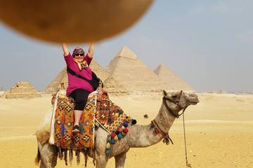 2-hour private camel ride or horse around Giza pyramids include pick up and drop off at hotel from Cairo Giza hotels