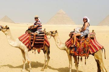 2 hours have fun Camel ride excursion by pyramids and have funny photos depend on ur request time from Cairo Giza hotels