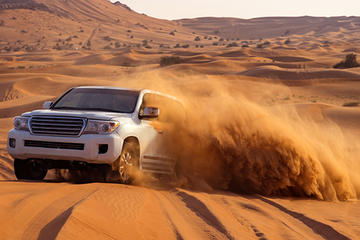 Abu Dhabi Desert Tour with Camel Ride, Sand Boarding, and BBQ