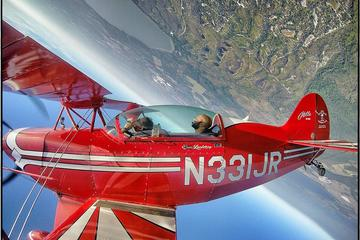 Day Trip 1-hour Aerobatic Bi-plane Sightseeing Flight and Demonstration near Kissimmee, Florida