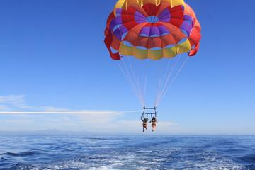 Round trip transfers to West Bay Beach with Parasailing included