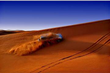 Desert Red Dune Safari with BBQ Dinner Camel Ride and Live Shows