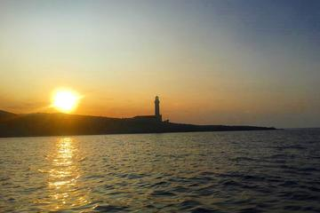 Sailing at sunset to Stoncica lighthouse alongside the coast of the island of Vis
