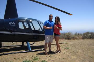 Passeio de helicóptero particular em...