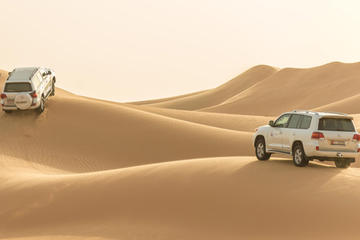 Dune Bashing Desert Safari in 4x4 with Camel Ride Sand Skiing and...