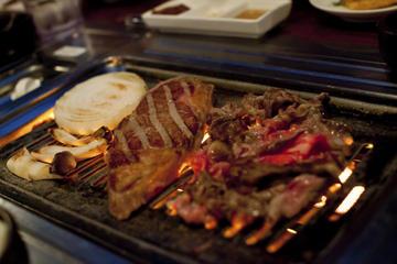 Tour gastronomico coreano serale per piccoli gruppi
