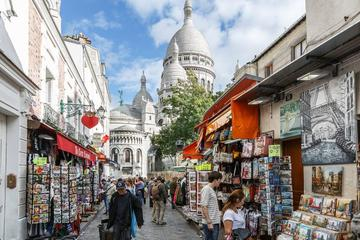 Montmartre walking tour up to the Sacre Coeur and skip the line to...