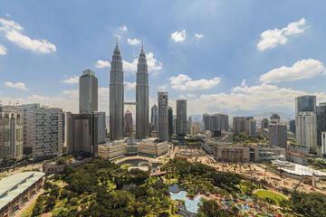 Privétour tijdens tussenstop in Kuala Lumpur: sightseeing in de stad ...
