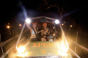 Entrada nocturna al parque de aventura Xplor con transporte