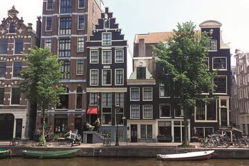 Tour in bici privato del centro città di Amsterdam al mattino o al
