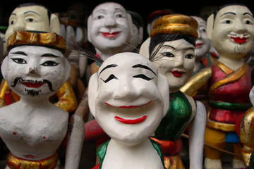 Water puppet show and Saigon River...