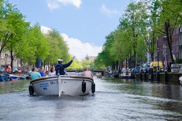 Rondvaart in een open boot door Amsterdam