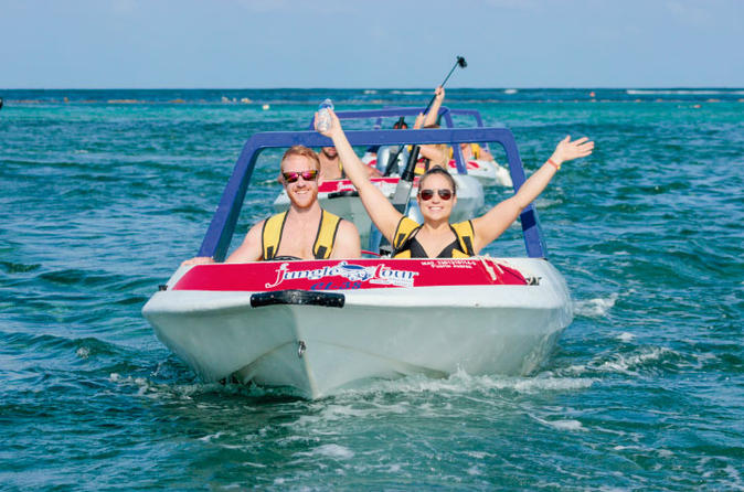 cancun jungle tour adventure speed boat snorkeling fun smiling hands arms up in air sky