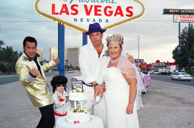 Pink Cadillac Wedding or Vow Renewal Ceremony at the Las Vegas Sign with Elvis