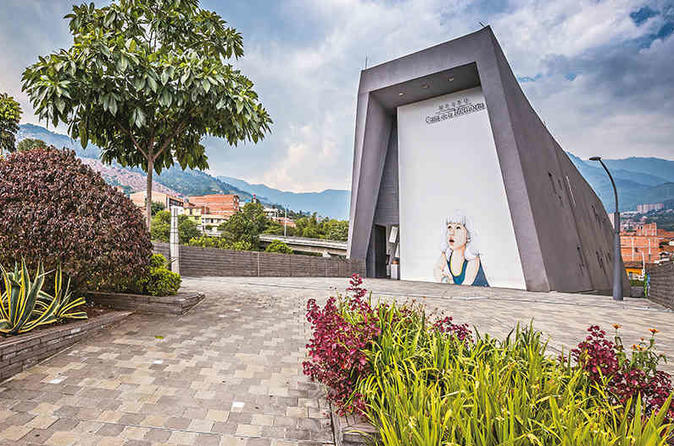 Medellin Transformation Tour from gray to green, Comuna 13, Pablo Escobar and Memory Museum!