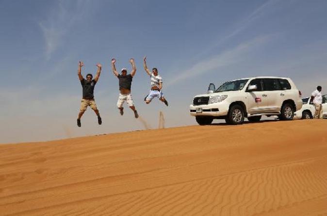Evening Desert Safari From Dubai Dune Bashing Camel Rides And Tanoura