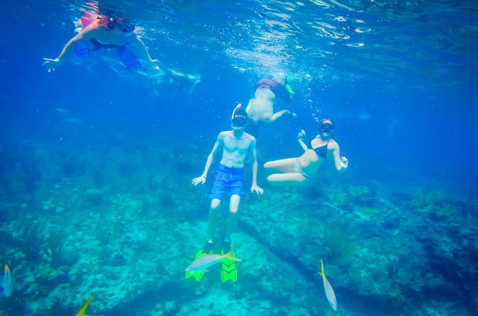 Freeport Reef Snorkeling Adventure with Beach Break and Shopping