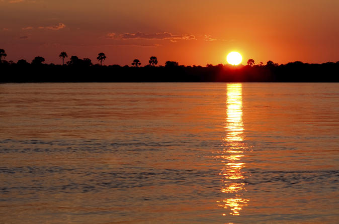Sunset Zambezi River Cruise with Transport from Victoria Falls