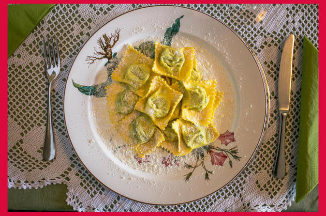 Dining experience at a Cesarina's home in Parma with show cooking
