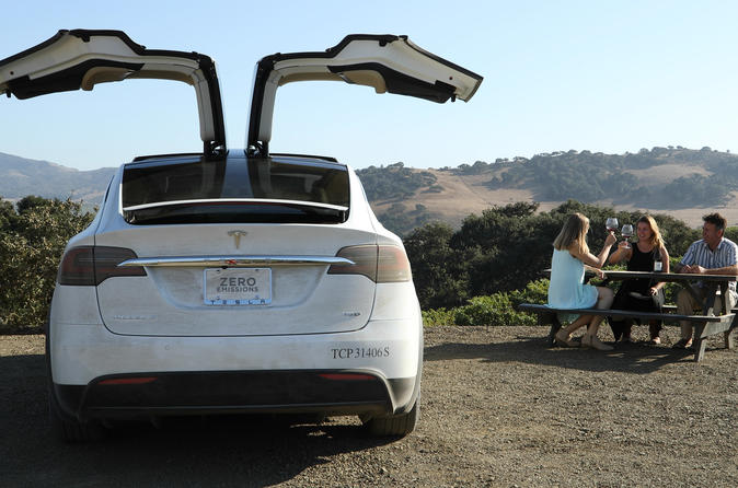 Visit Small-Production Private Estates, Vineyards & Wineries in Luxury Tesla SUV
